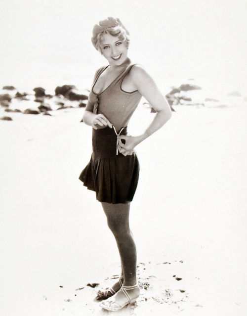 Joan Blondell unzipping scandalous