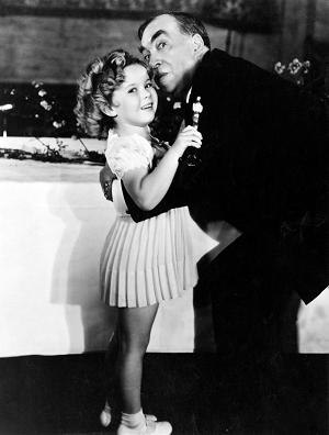 Special Juvenile Award winner Shirley Temple gets a hug from Host Irving S. Cobb.