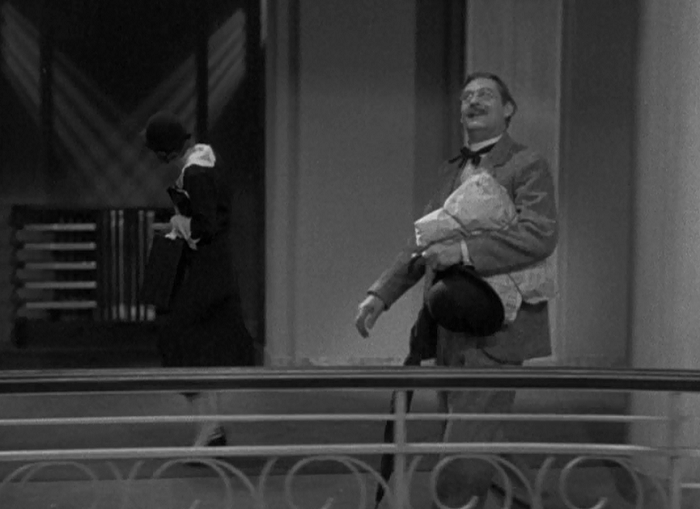 There's a few early scenes where we have different character's actions overlapping-- Crawford in the back looking for the correct room while Barrymore admires the view with childlike joy. Again, to Gaulding's credit, moments like these sing.