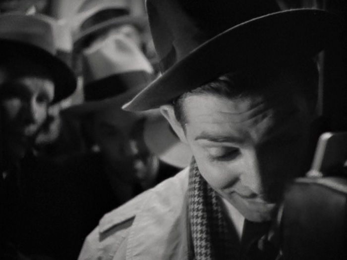 Gable's excellent entrance (in extreme close-up to show how plastered he is) reveals a man who is overconfident, easily goaded, and who wants to be liked in spite of these qualities.