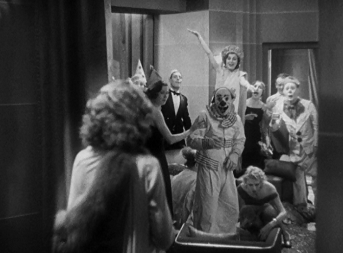 Stanwyck walks in on the carnie party to discover them openly mocking her routine. Capra openly compares her work to that of the carnival workers who hold themselves above their audience and fleece them with glee. This shot shows Stanwyck on the outside seeing how awful this looks from the outside, and she's about to be drawn in...