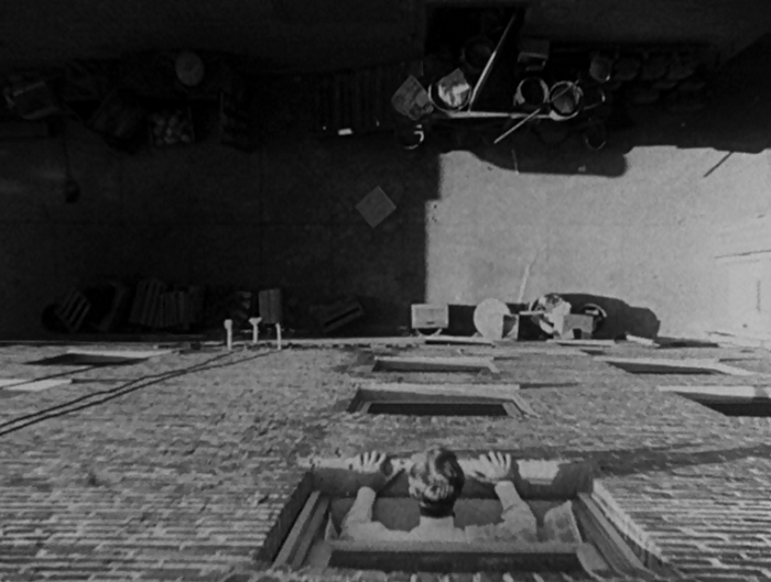This is our first shot of John as he contemplates ending his life. What I like about this perspective is A) how mundane the alley he's considering jumping into is, and B) that we're looking down below, but at this point in the movie, we don't know that John is blind. So we're looking at the plain mundane sadness he's contemplating, but with information the character doesn't have.