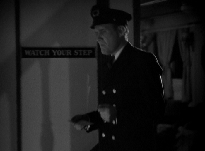 That sign on the wall represents a pretty black gag on Capra's part as the scene before this shows someone losing their step to a near-fatal degree.