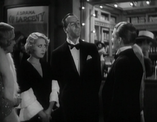 One of the better jokes in the film is that sign behind the quartet of grifters.