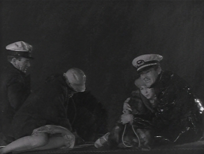 In other 'famous actors appear in the margins', check out Brown's co-pilot on the left. Yep, that's John Wayne.