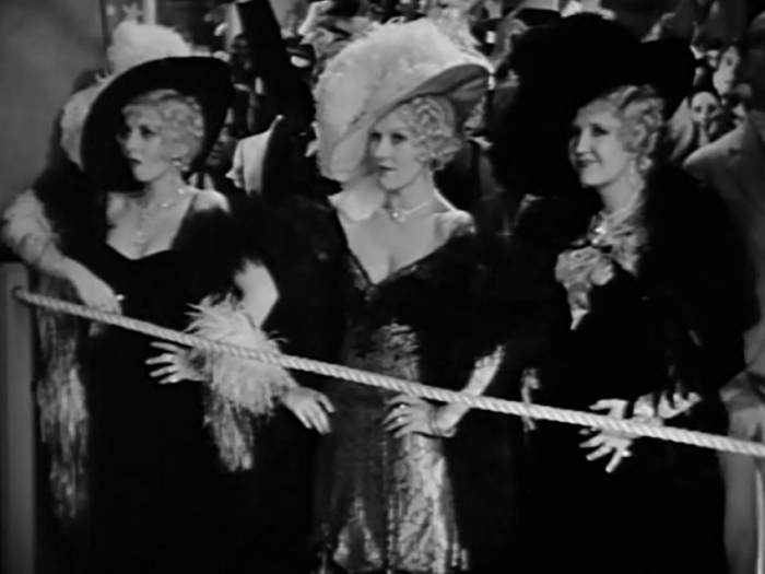 The movie also features not one, but THREE Mae West impersonators. Really, everything but the kitchen sink.