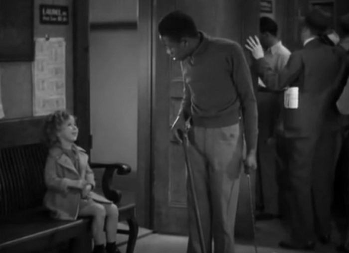 Here's little Shirley Temple, showing everyone the right way to wage total racial hegemony.