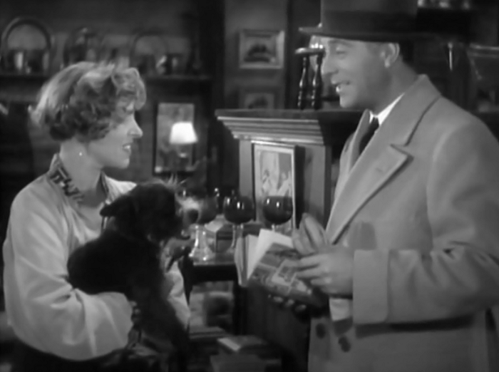 Pre-Code dog alert: the owner of a store where Jimmy sells his paintings has to take out her dog for a minute. Cortez seems perfectly amused with the little pup.