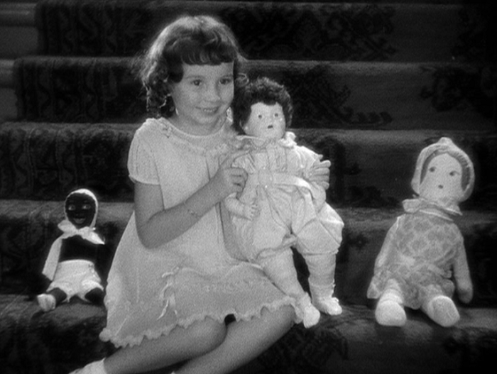 For all of the nice moments between the races in this movie, let's not talk about that doll on the left.