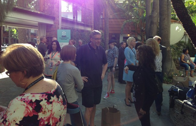 A crowd gathers for the 'Going to the TCM Film Festival!' event.