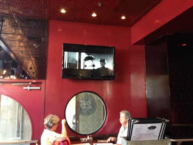 Grabbing a quick bagel in the morning at the Roosevelt's cafe and watching a certain TV show.