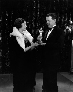 Presenter Jack Cunningham gives writer Frances Mario the Best Writing Oscar for The Big House.