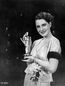 Norma Shearer holds her Oscar for Best Actress.