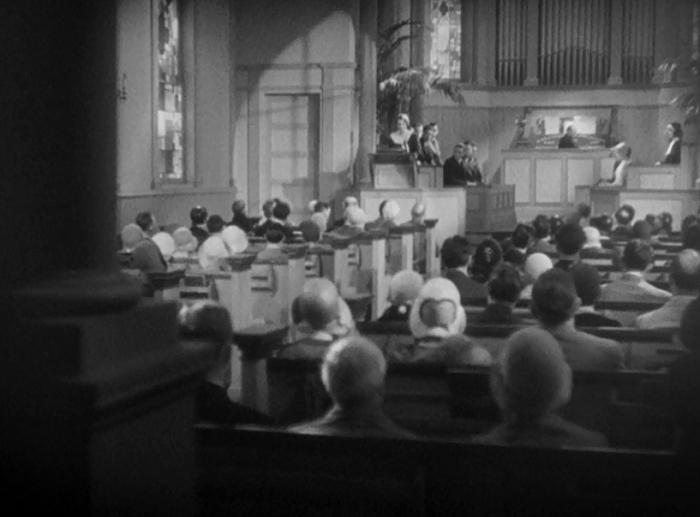 The early shots of Fallon in her father's church do some interesting things, often looking up at her to give her the illusion of power. Here we see her from the back of the church, almost lurking behind a pillar. Her anger and sadness is so palpable here, the camera almost seems to want to run away from its power.