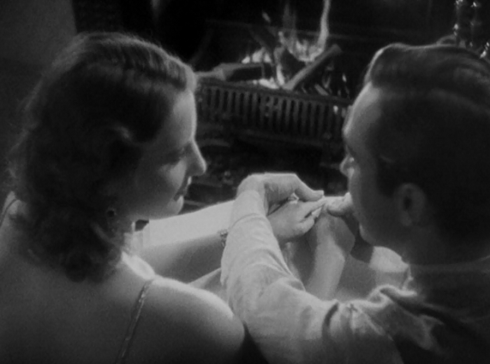 This shot has us peering over John and Florence's shoulders. It's brief, but very intimate. I should have more to say here, but it's just a wonderful moment as he begins to read a Bible verse from reading the braille and she finishes it for him from memory.