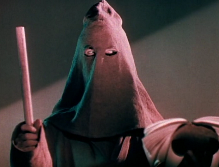 One quick question: who is the character under this mask? Because every other nefarious character is pretty much accounted for during this scene.