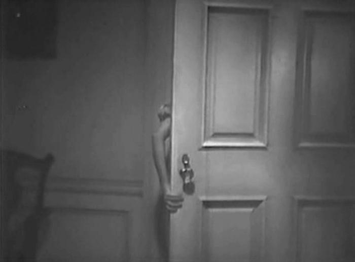 Preparing to make love to a doorknob.