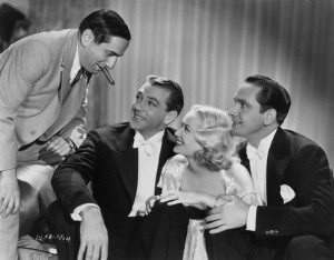 Ernst Lubitsch on the left with Gary Cooper, Miriam Hopkins, and Frederic March on the set of Design for Living (1933).