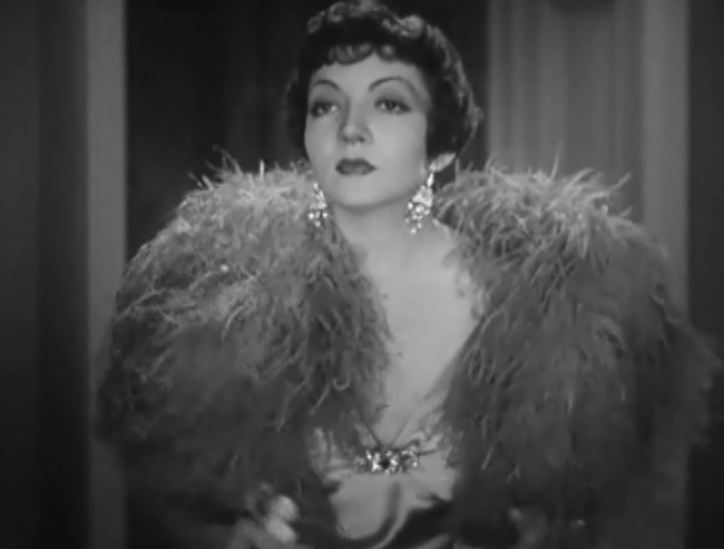 Claudette Colbert's wardrobe is worth seeing. That's why I took screencaps.